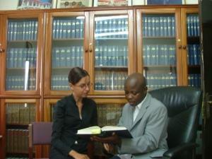 Female volunteer reading in Ghana