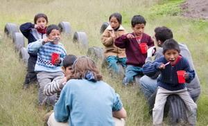 Volunteer educate children on brushing their teeth