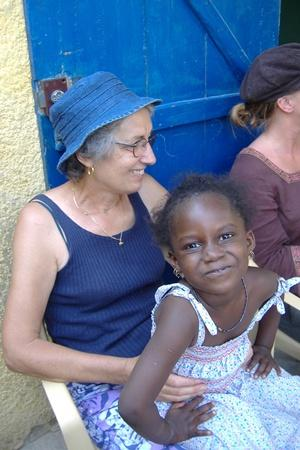 Older care volunteer with child in Senegal