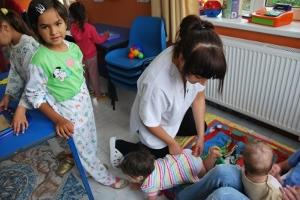 British volunteer Sophie with the babies in the playroom at the Sacele Hospital