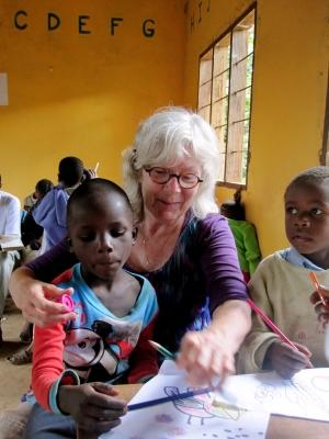 Older volunteer with 1 child on a care project