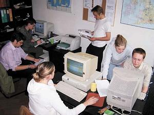 Volunteers working on a magazine