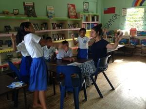 Projects Abroad Samoa volunteer plays a game with children at her placement in Apia.