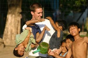Male volunteer playing with kids